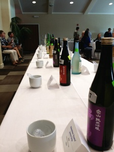 A variety of sake lined up ready for sampling.